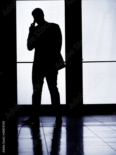 silhouette man phoning
