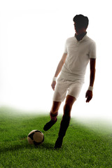 Football player score goals on grass with white background
