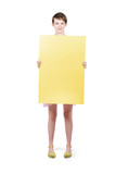 Retail girl holding empty yellow banner