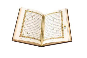 The Holy Quran over white background