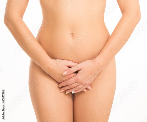 Curvy woman covering herself with her hands