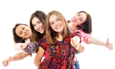 group of happy teen girls with thumbs up, over white
