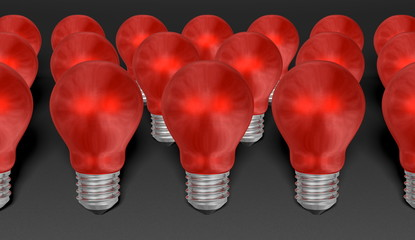Group of red reflective light bulbs on grey background