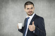smiling businessman recommend coffee
