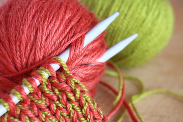 Wool and knitting needles closeup.