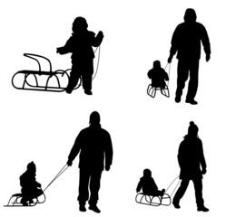 sledding silhouettes - vector