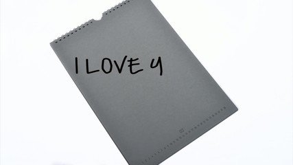 notepad writing I love you and hearts