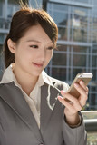 Young business woman use cellphone