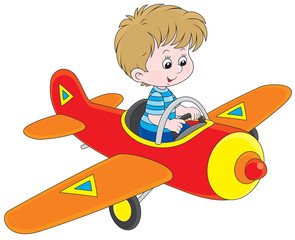 Little boy flying a toy plane