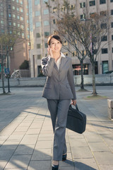 sunset business woman on cellphone
