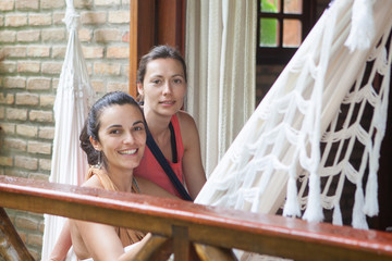 women relaxing during holidays in a hammock