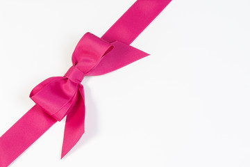Hot pink ribbon isolated on white