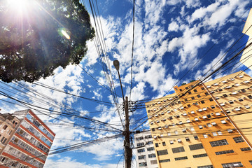 View from below of electrical lines on power pole in Rio de Jane