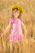 Happy child in wheat field