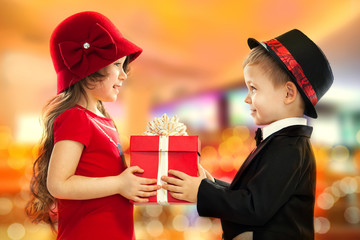 Little boy giving girl gift