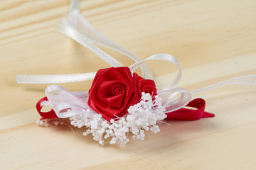 Red rose with white decoration