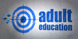 Education concept: target and Adult Education on wall background