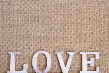 Word love on burlap Shabby chic background