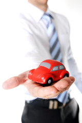 macro red toy car in businessman hand