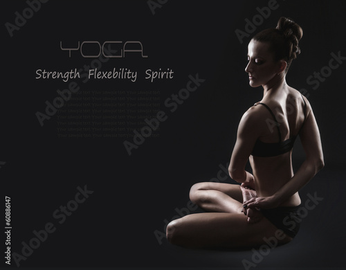 Slim woman in twisted yoga pose