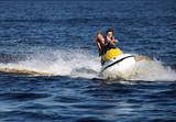Fototapety Couple riding jet ski