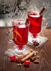 two glasses of mulled wine  on old wooden table