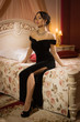 Elegant brunette in a luxurious interior.