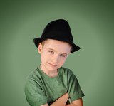 Fashion Boy with Hat on Green Background
