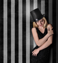 Beautiful Glamour Girl Standing Against Striped Wall