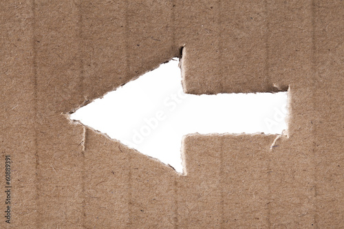 Arrow cut into cardboard