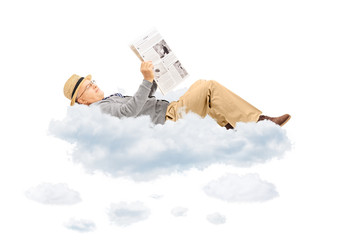 Senior gentleman reading newspaper laying on clouds