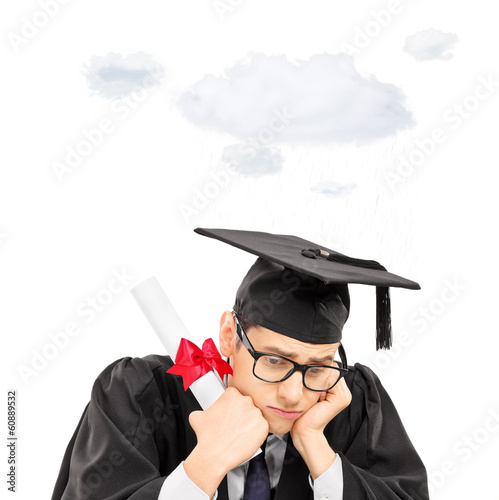 Sad graduate student holding diploma with a cloud over his head