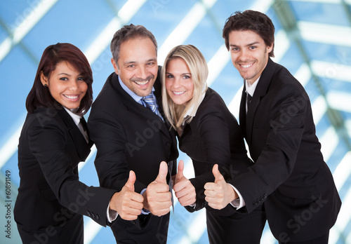 Happy business team celebrating a success