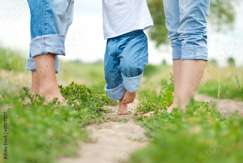 Happy family on a walk in summer