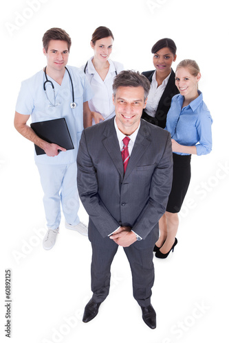 Businessman In Front Of  Professional Workers