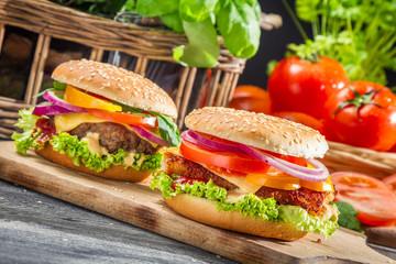 Closeup of two homemade hamburgers