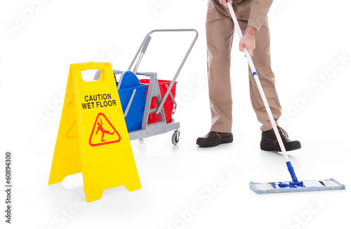 Sweeper Cleaning Floor With Warning Sign