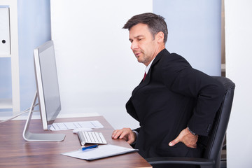 Businessman Suffering From Back Pain