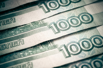 Thousand russian roubles, close-up. Color toned image.