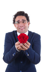 nerd with expression holding flower