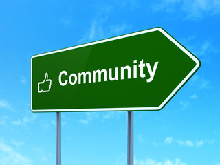 Social network concept: Community and Thumb Up on road sign