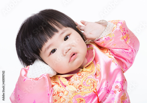 Baby girl with traditional chinese clothing and having funny pos