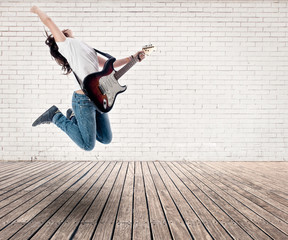 girl jumping with electric guitar