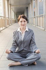 business woman do lotus position