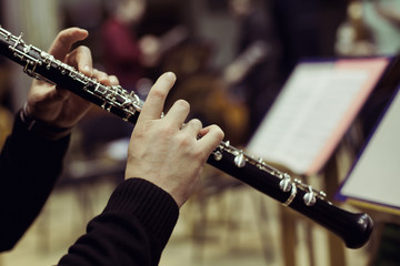 Human hands playing the oboe