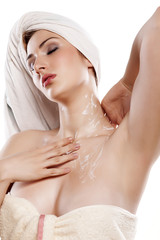 young pretty girl in towels applied lotion on her neck