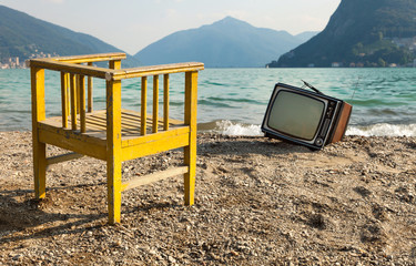 vintage decor on the lake shore,.chair and television