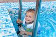 Cute little boy enjoying a swim in a pool