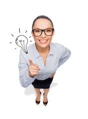 smiling businesswoman with finger up