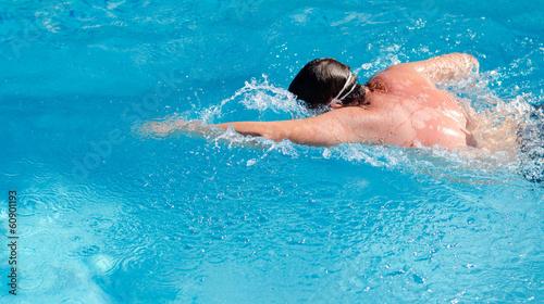 Man swimming in a pool doing the crawl